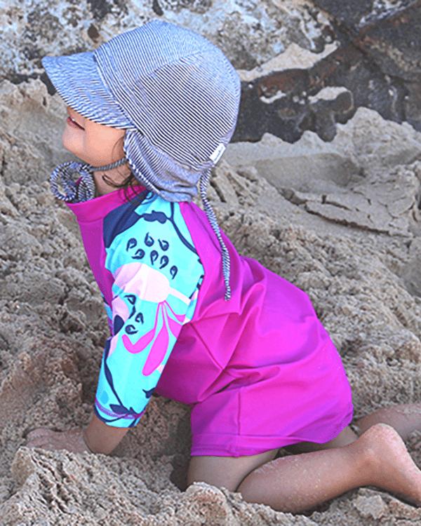 Child wearing Girls Pink Short Sleeved Logo Rashie